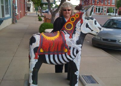 Laurie with one of the Wild Dala Horses of Lindsborg, KS