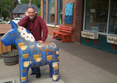 Neil with one of the Wild Dala Horses of Lindsborg, KS