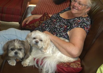 Laurie with Lucy and Luna, a pair of Shih Tzu crosses